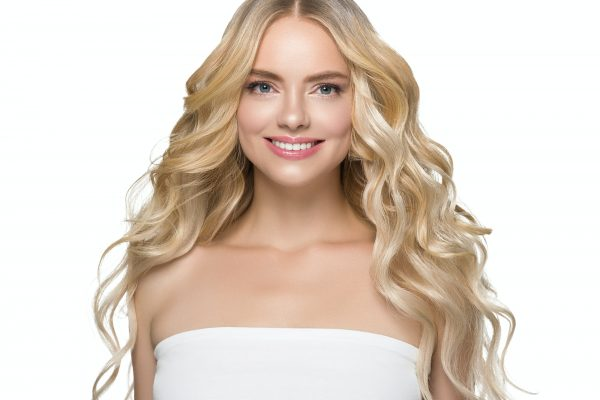 Teeth smile woman face blonde hair natural make up clean beauty healthy skin hait and teeth